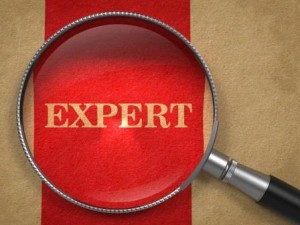 Expert - Concept with Magnifying Glass.